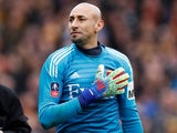 Watford's Heurelho Gomes gestures to the fans at the end of the FA Cup match against Crystal Palace on March 16, 2019