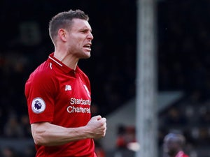 Liverpool survive Fulham scare to move top