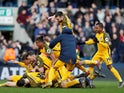 Brighton & Hove Albion players celebrate their penalty shootout victory over Millwall in the FA Cup quarter-finals on March 17, 2019