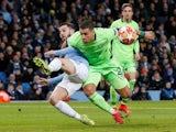Schalke's Jeffrey Bruma fouls Manchester City's Bernardo Silva for a penalty on March 12, 2019