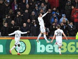 Swansea City's Matt Grimes celebrates scoring their first goal against Manchester City on March 16, 2019