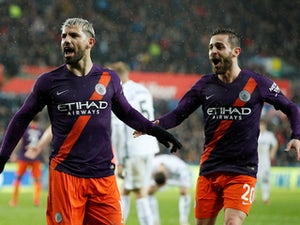 Man City survive Swansea scare to reach semis