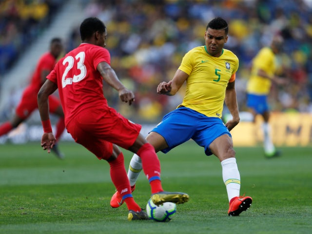 Brazil's Casemiro in action with Panama's Michael Murillo during an international friendly on March 23, 2019