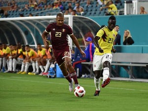 Colombia's Davinson Sanchez battles Venezuela's Salomon Rondon for the ball in September, 2018