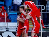 Daniel James is mobbed by Wales teammates after scoring on March 24, 2019