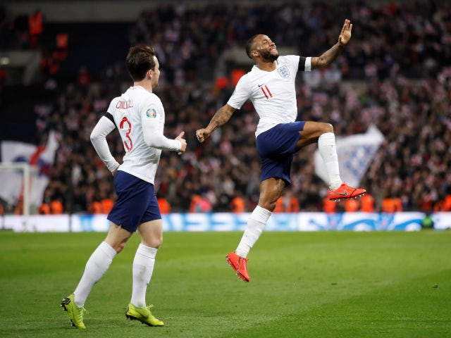 Raheem Sterling celebrates with Ben Chilwell after completing his hat-trick in England's comfortable win against Czech Republic on March 22, 2019