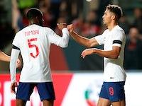 England's Dominic Calvert-Lewin celebrates scoring their first goal with Fikayo Tomori on March 21, 2019