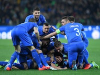 Nicolo Barella is mobbed by teammates after scoring for Italy on March 23, 2019