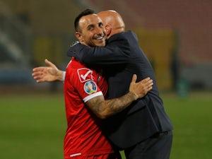 Michael Mifsud and Ray Farrugia celebrate Malta's win over Faroe Islands on March 23, 2019