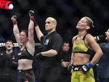 Molly McCann (red gloves) defeats Priscila Cachoeira (blue gloves) during UFC Fight Night at O2 Arena in March 2019
