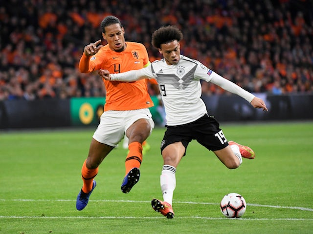 Germany's Leroy Sane tangles with Netherlands's Virgil van Dijk in their Euro 2020 qualifier on March 24, 2019