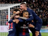 Paris St Germain's Kylian Mbappe celebrates scoring their first goal against Marseille with Marco Verratti and teammates On March 17, 2019