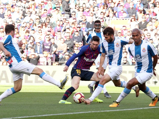 Lionel Messi is crowded out by players during the derby clash between Barcelona and Espanyol on March 30, 2019