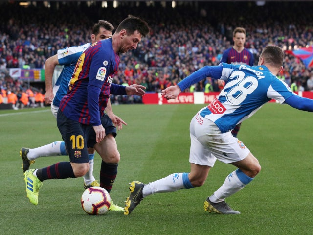 Barcelona forward Lionel Messi attempts to get away from a couple of Espanyol players at Camp Nou on March 30, 2019
