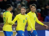 Brazil's Gabriel Jesus celebrates scoring their second goal with Arthur and Roberto Firmino on March 26, 2019