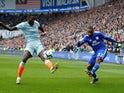 Cardiff City's Junior Hoilett in action with Chelsea's Antonio Rudiger during their Premier League clash on March 31, 2019