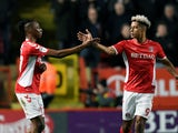 Charlton Athletic's Joe Aribo celebrates a goal with teammate Lyle Taylor in March 2019