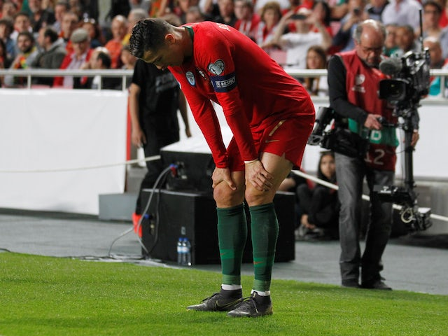 Cristiano Ronaldo stands injured for Portugal before leaving the field on March 25, 2019
