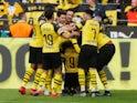 Paco Alcacer celebrates with Borussia Dortmund teammates on March 30, 2019