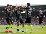 Manchester City players celebrate Bernardo Silva's goal against Fulham in the Premier League on March 30, 2019