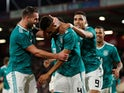 Germany's Felix Uduokhai celebrates scoring their second goal with teammates  against England on March 26, 2019