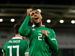 Magennis and Washington both want credit for Northern Ireland opener