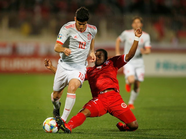 Spain's Marco Asensio is challenged by Malta's Joseph Mbong during their Euro 2020 qualifier on March 26, 2019