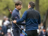 Kevin Kisner (left) shakes hands with Francesco Molinari on the 18th green during the semifinal round of the WGC - Dell Technologies Match Play golf tournament at Austin Country Club on March 31, 2019
