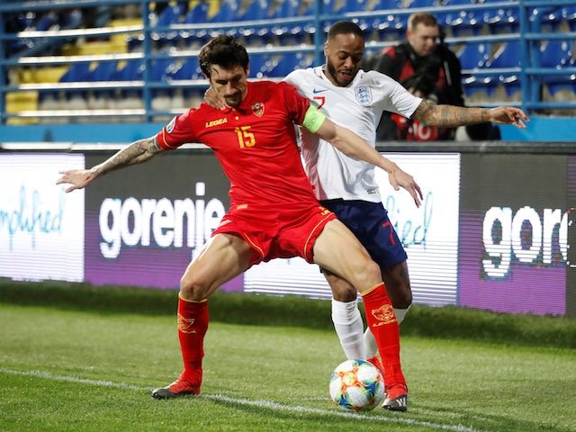 Montenegro's Stefan Savic and England's Raheem Sterling in action during their Euro 2020 qualifier on March 25, 2019