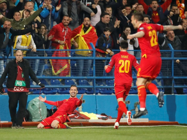 Montenegro players celebrate scoring against England in their Euro 2020 qualifier on March 25, 2019