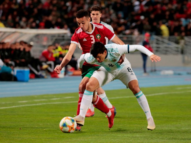 Morocco's Noussair Mazraoui in action with Argentina's Marcos Acuna during the international friendly on March 26, 2019