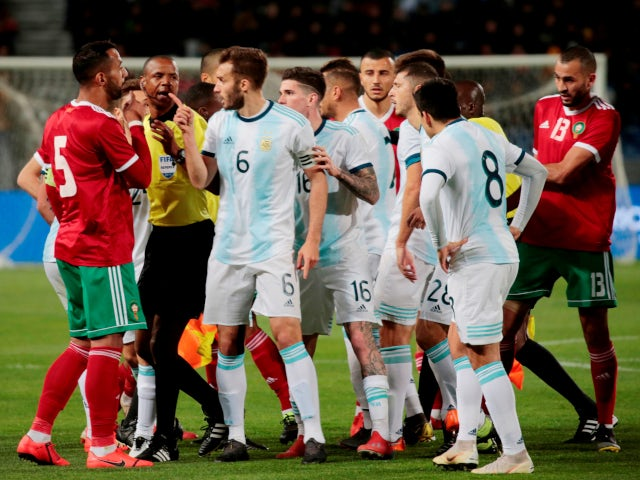 Argentina's German Pezzella clashes with Morocco's Medhi Benatia on March 26, 2019