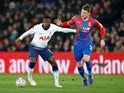 Tottenham Hotspur's Victor Wanyama in action with Crystal Palace's Connor Wickham during an FA Cup tie in January 2019