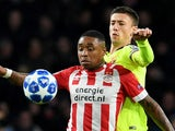 PSV Eindhoven's Steven Bergwijn in action with Barcelona's Clement Lenglet during a Champions League clash in November 2018
