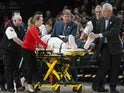 Portland Trail Blazers center Jusuf Nurkic (27) wheeled off the court after injuring his leg during a second overtime against the Brooklyn Nets at Moda Center on March 25, 2019