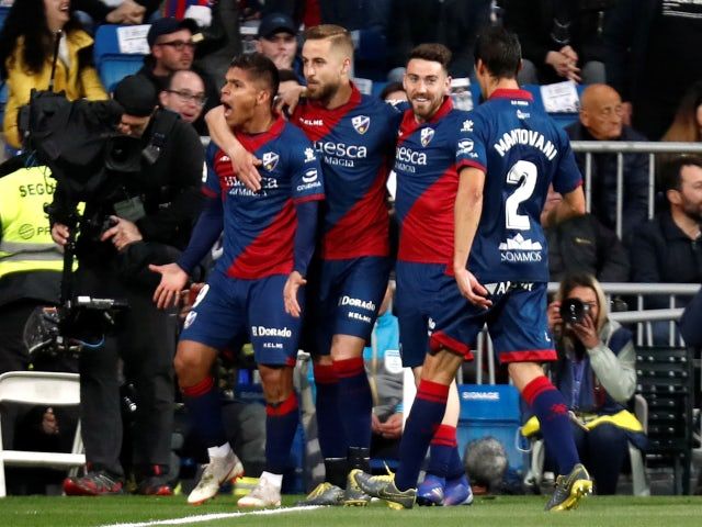 Huesca's players celebrate opening the scoring at the Bernabeu through Juan Camilo Hernandez's early strike on March 31, 2019