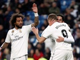 Marcelo joins in the celebrations with Karim Benzema following the French striker's goal against Huesca on Mach 31, 2019