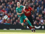 Manchester United's Paul Pogba tangles with Watford's Will Hughes during their Premier League clash on March 30, 2019