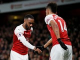 Alexander Lacazette celebrates his goal against Newcastle United with Arsenal teammate Pierre-Emerick Aubameyang on April 4, 2019