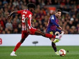 Barcelona's Lionel Messi in action with Atletico Madrid's Thomas Partey in La Liga on April 6, 2019