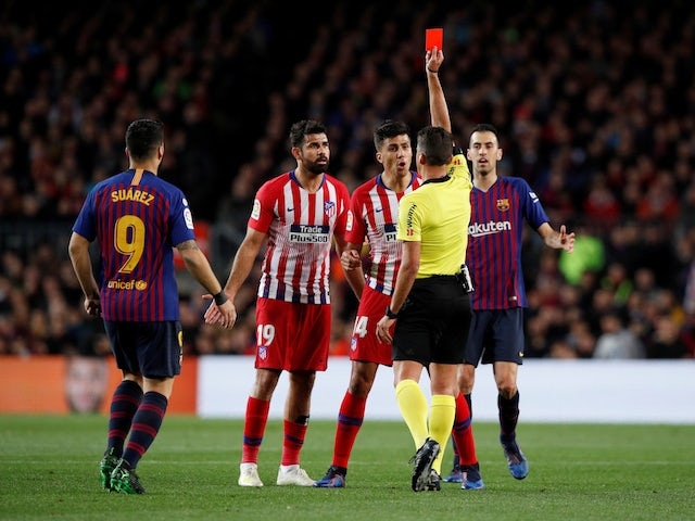 Atletico Madrid forward Diego Costa picks up a red card during his team's La Liga clash with Barcelona on April 6, 2019