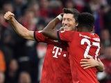 Bayern Munich's Robert Lewandowski celebrates scoring their fifth goal with David Alaba during their Bundesliga clash with Borussia Dortmund on April 6, 2019