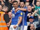 Che Adams is hugged from behind after scoring for Birmingham City on April 6, 2019