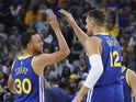 Golden State Warriors guard Stephen Curry (30) celebrates with center Andrew Bogut (12) against the Charlotte Hornets during the second quarter at Oracle Arena on April 1, 2019