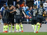 Manchester City players celebrate the opening goal against Brighton in their FA Cup semi-final on April 6, 2019
