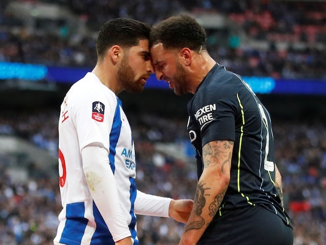 Manchester City's Kyle Walker goes head to head with Brighton's Alireza Jahanbakhsh on April 6, 2019