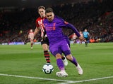 Liverpool's Roberto Firmino keeps the ball in play during the Premier League clash with Southampton on April 5, 2019