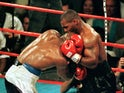 Mike Tyson bites Evander Holyfield's ear in 1997