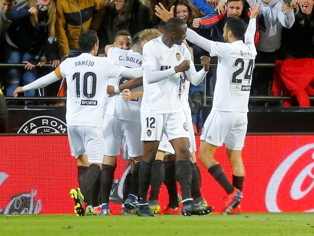 Valencia's Goncalo Guedes celebrates scoring with teammates during their game with Real Madrid on April 3, 2019