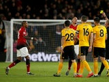 Manchester United's Ashley Young receives a second yellow card against Wolverhampton Wanderers in the Premier League on April 2, 2019.